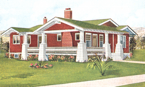 A green roof on a red brown craftsman style house